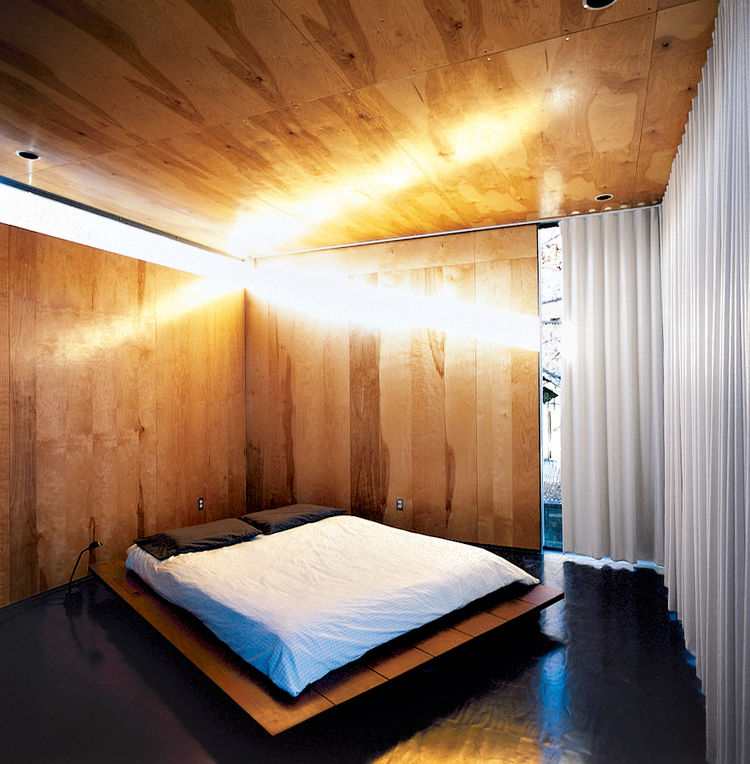 Modern bedroom with wooden floors.