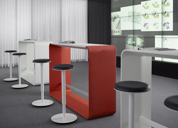 Open offices can benefit from flexible furniture arrangements like this standing height table called Hoop from Haworth.