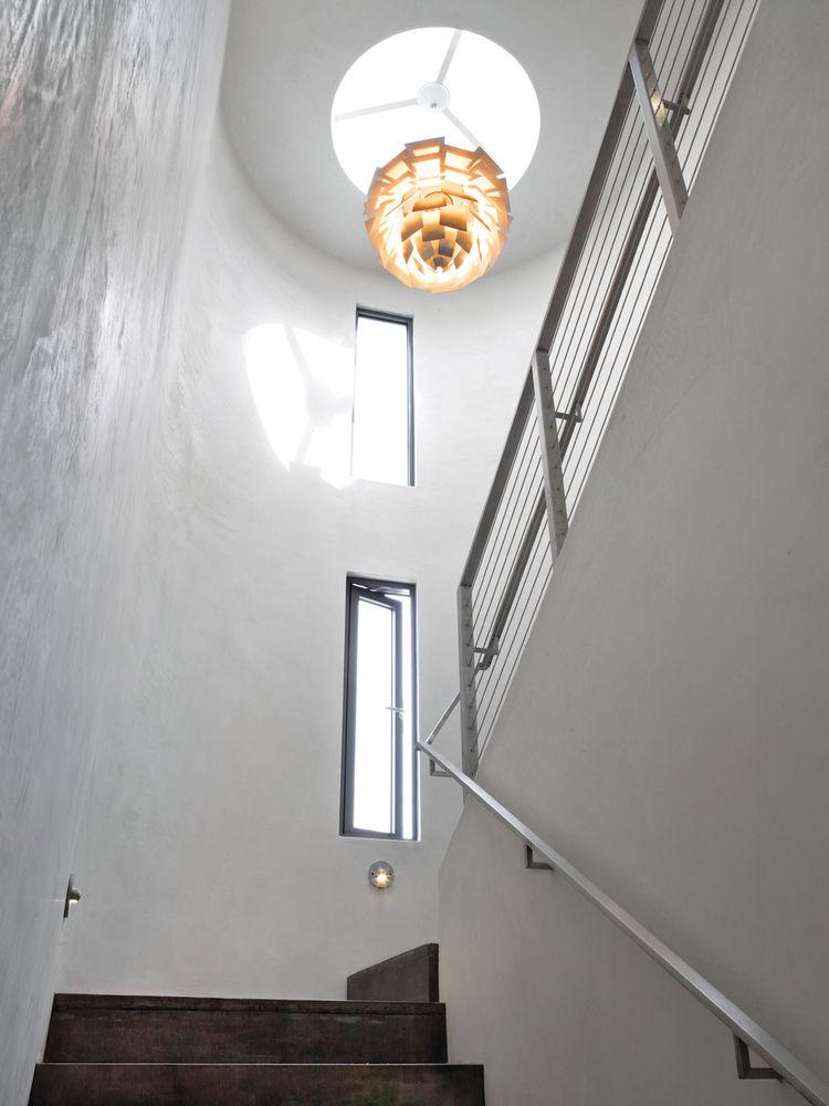 Bryan Cranston beach house Henningsen lamp