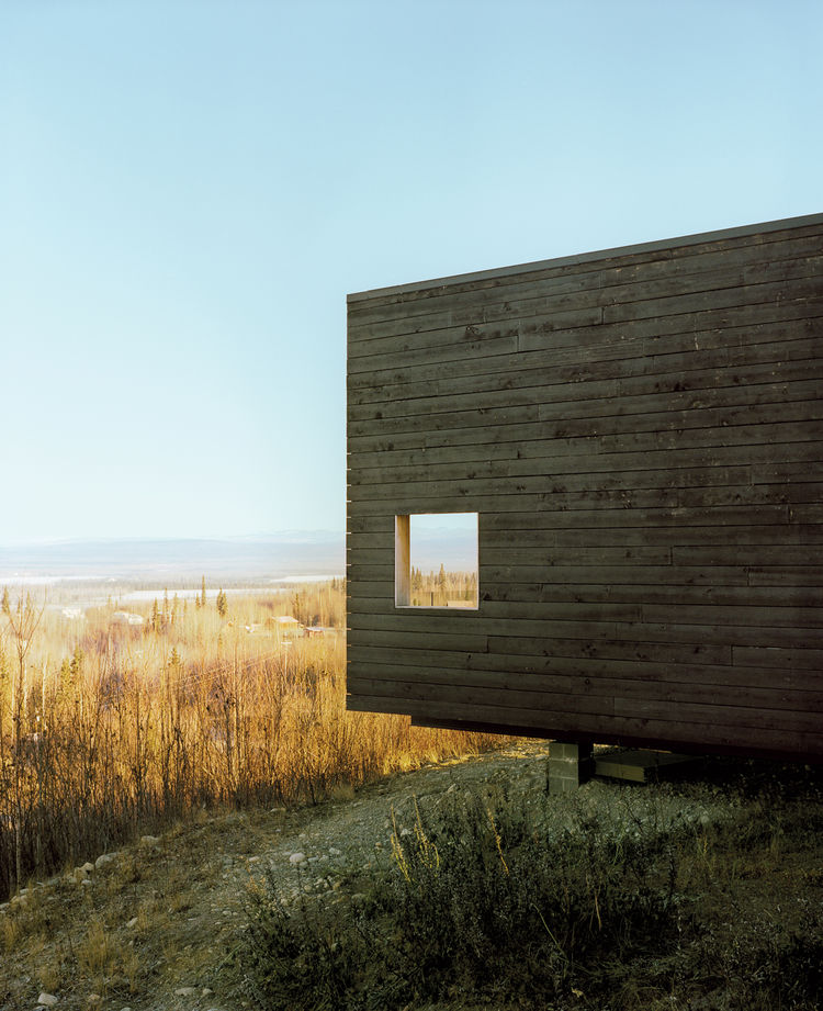 Modernist charred cedar cabin in Alaska