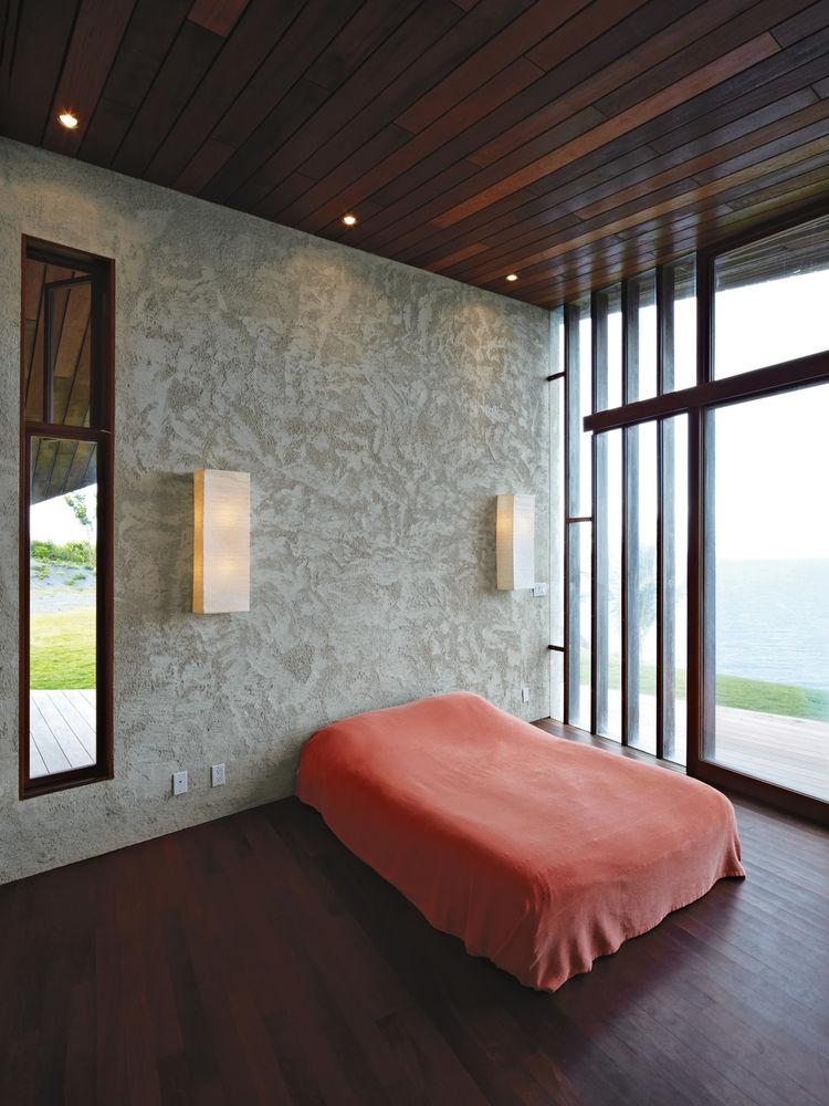 Plastic platform bed in master bedroom.