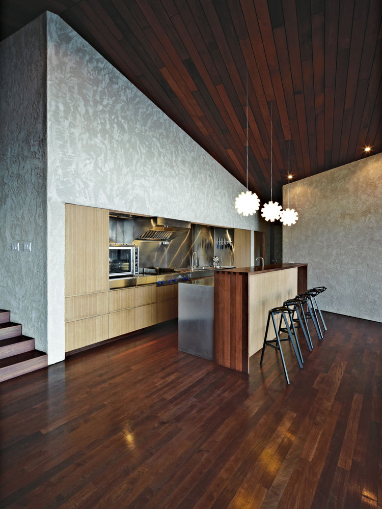 Kitchen with integrated bamboo plywood furniture.