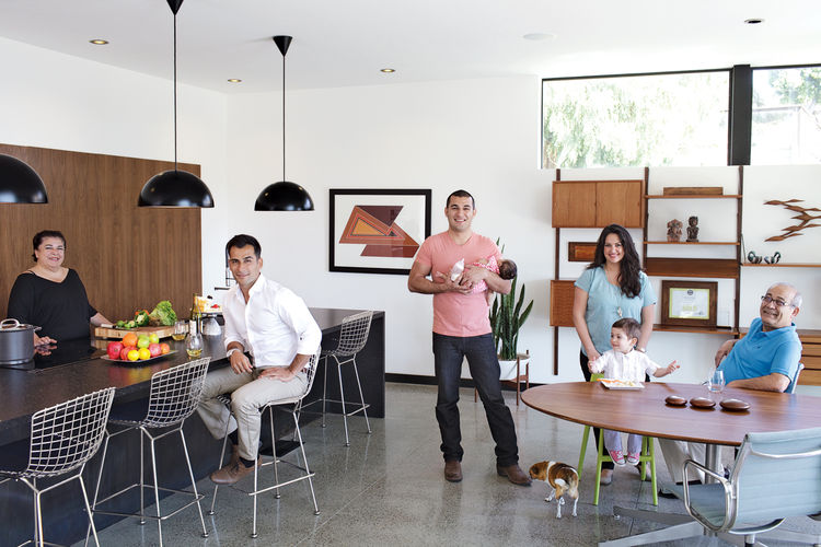 Family gathered in kitchen