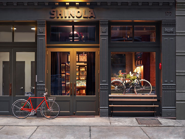 Shinola flagship store selling bicycles, leather goods, watches in Tribeca New York City designed by Rockwell