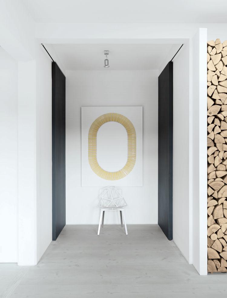 Modern bathroom hallway with hanging art
