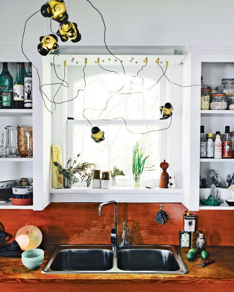 Modern kitchen with 57 chandeliers by Bocci