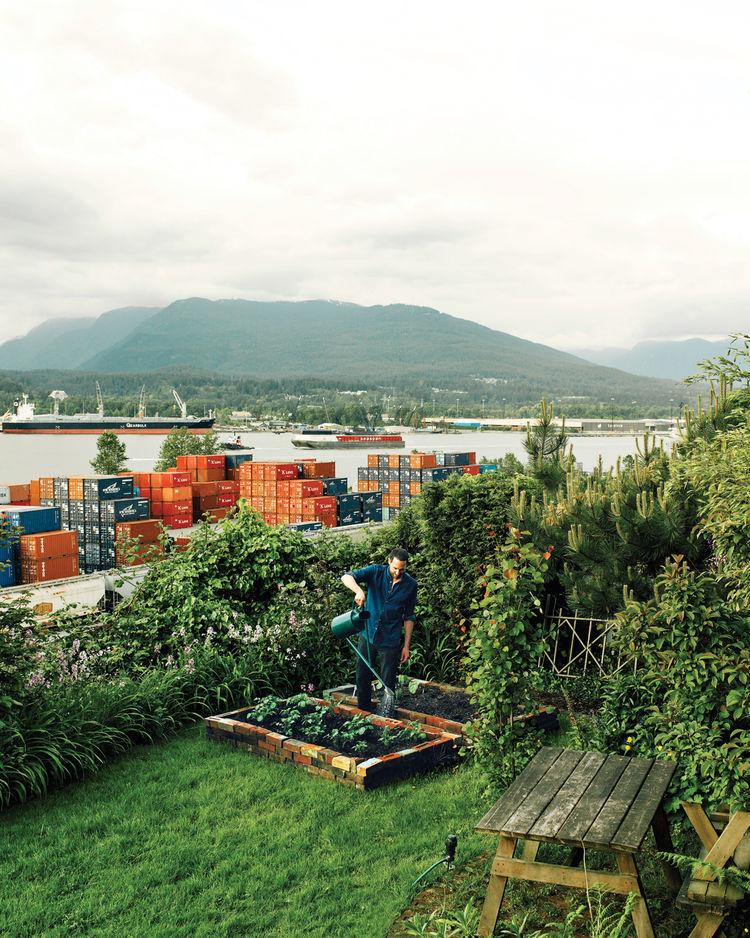 Designer Omer Arbel watering his outdoor garden