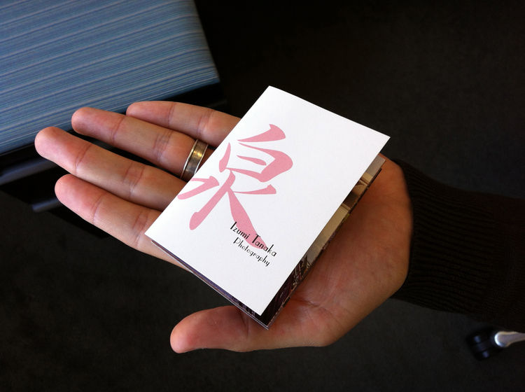 Dwell's Brian Karo holds Izumi's promo so you can see just how tiny it is. small booklet hand wedding ring