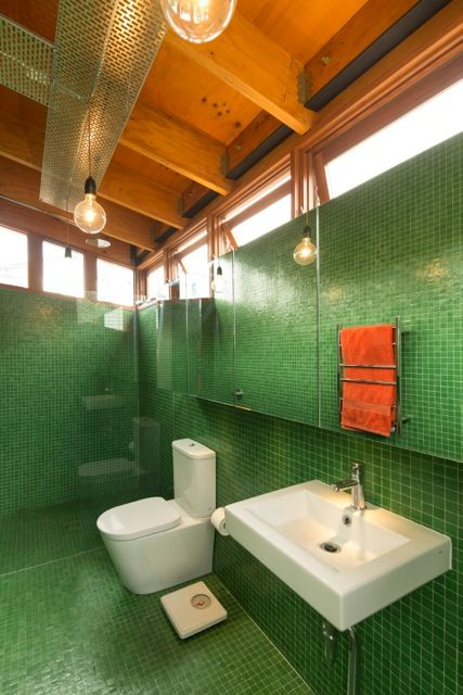 bathroom in a modern house with green mosaic tile floor