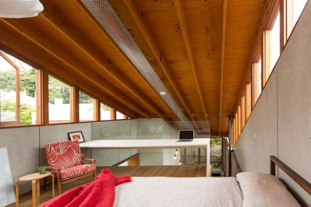 modern bedroom with exposed ceiling rafters
