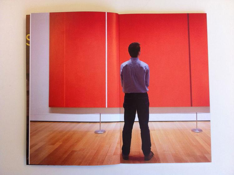 Interior spread of Dennis Burnett's promo. man standing alone orange back