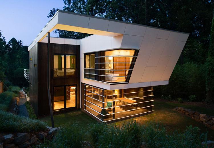 modern house with concrete and cor-ten steel rainscreen