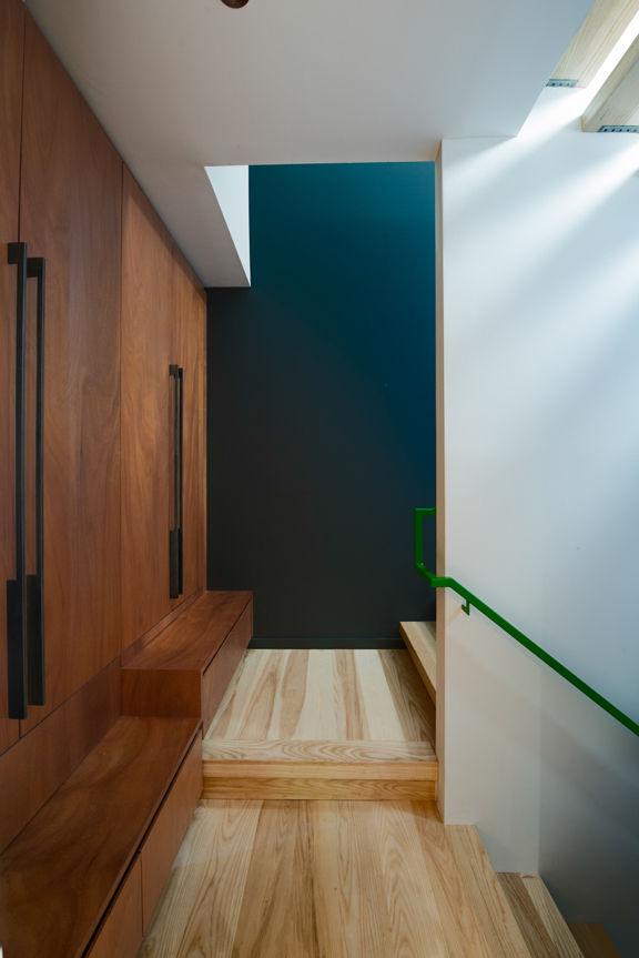 hallway with mahogany cabinets and ash floor