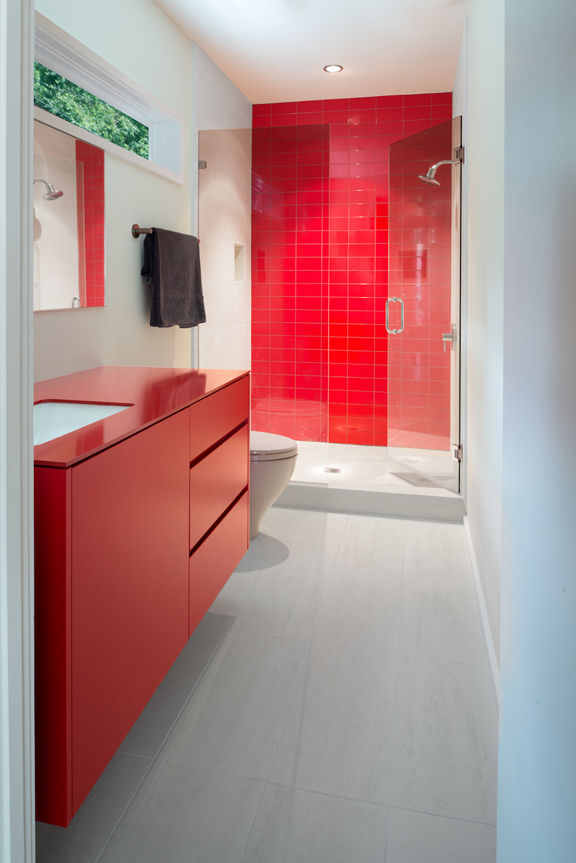 bathroom with red vanity