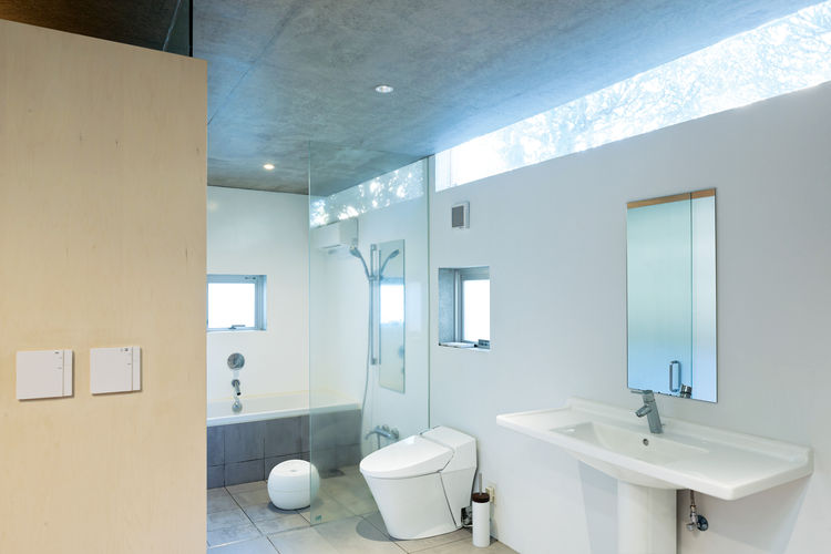 open plan concrete home in japan bathroom