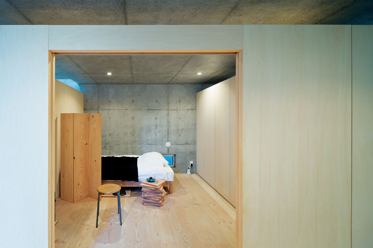 open plan concrete home in japan bedroom
