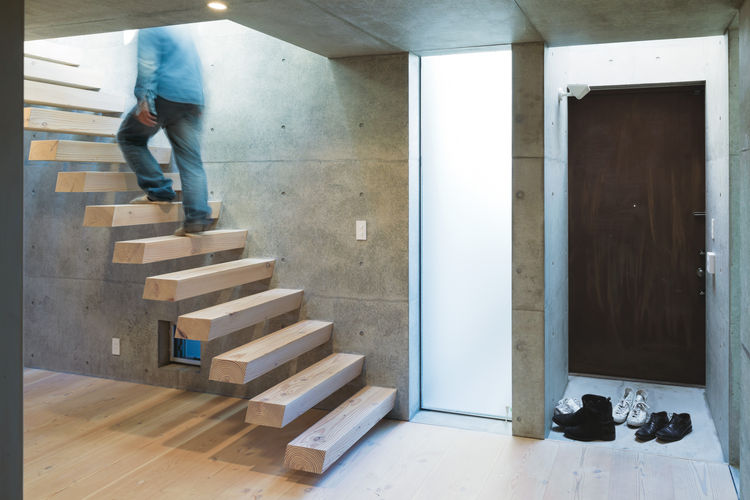 open plan concrete home in japan entryway