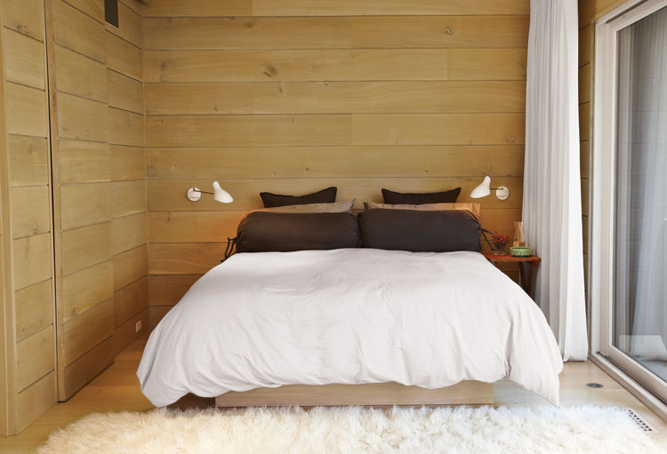 sustainable mid-century beach house interior bedroom