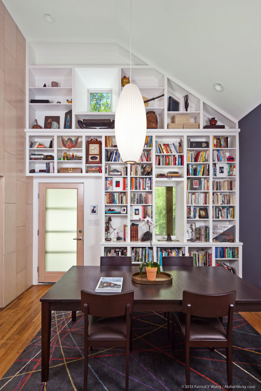 Dining library J.C. Scmeil Merzbau Design Collective Austin Texas family home renovation remodel budget