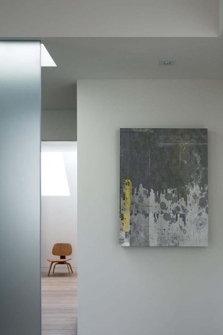 hallway in modern house with frosted glass wall