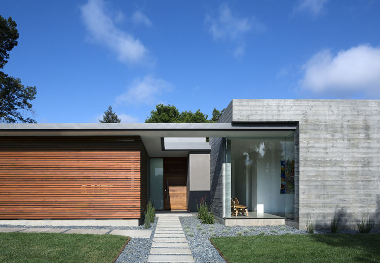 modern passive house with concrete and ipe facade