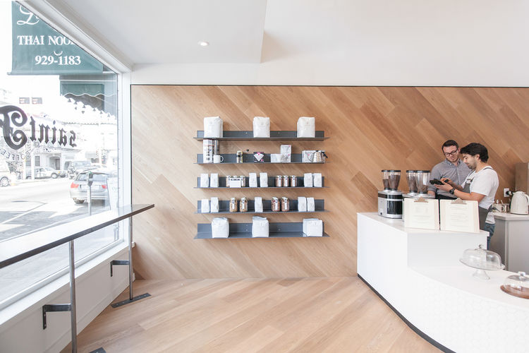 modern cafe saint frank coffee in san francisco with metal shelves