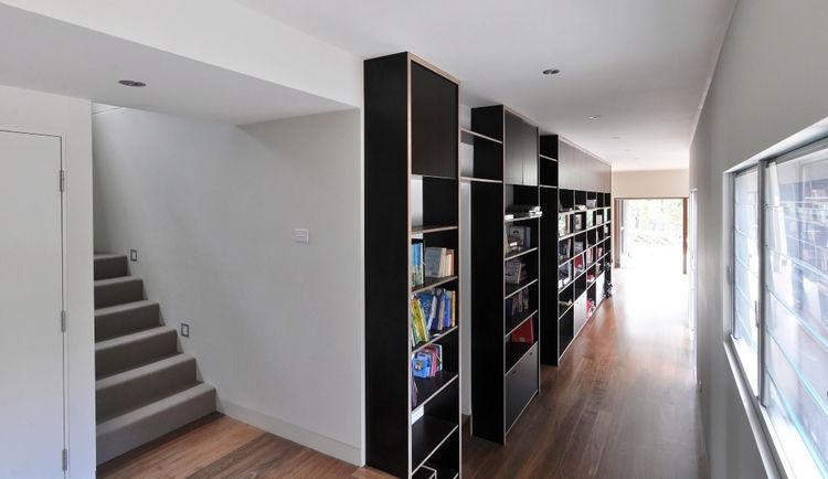 modern house with black built-in shelves