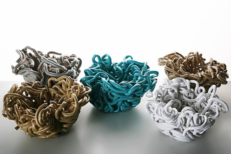 colorful ceramic bowls created from tangled clay strings