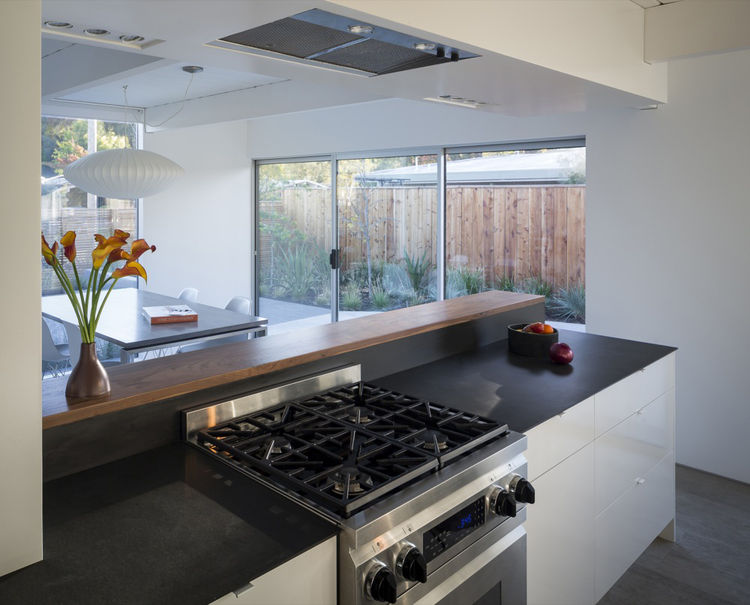 a view from the kitchen of a renovated Eichler into the backyard