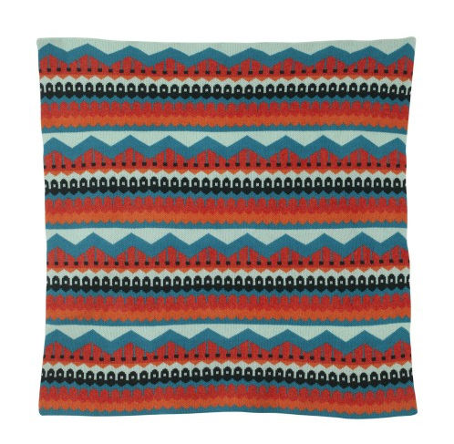 a lambswool blanket with an elaborate multicolored pattern
