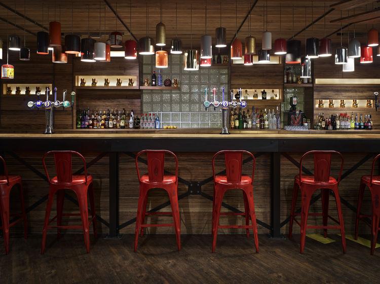 Generator London bar red chairs hostel