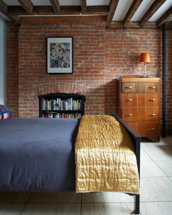 williamsburg bedroom exposed brick wall