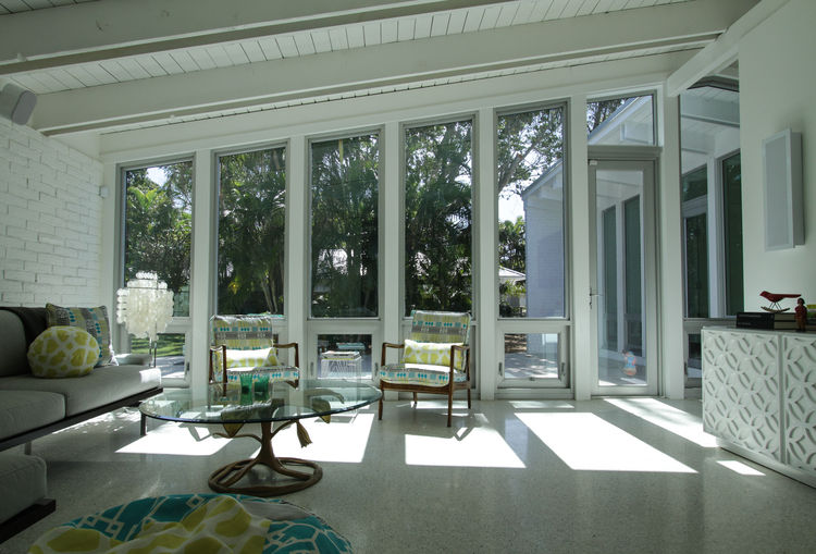 palm beach house living room with windows