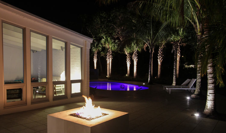 palm beach house pool at night