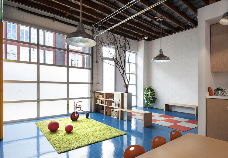 modern preschool with blue floors and green rug
