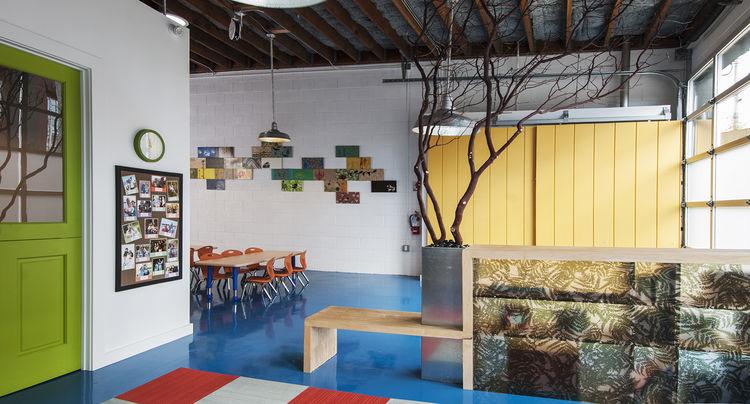 preschool in industrial space with blonde shelving