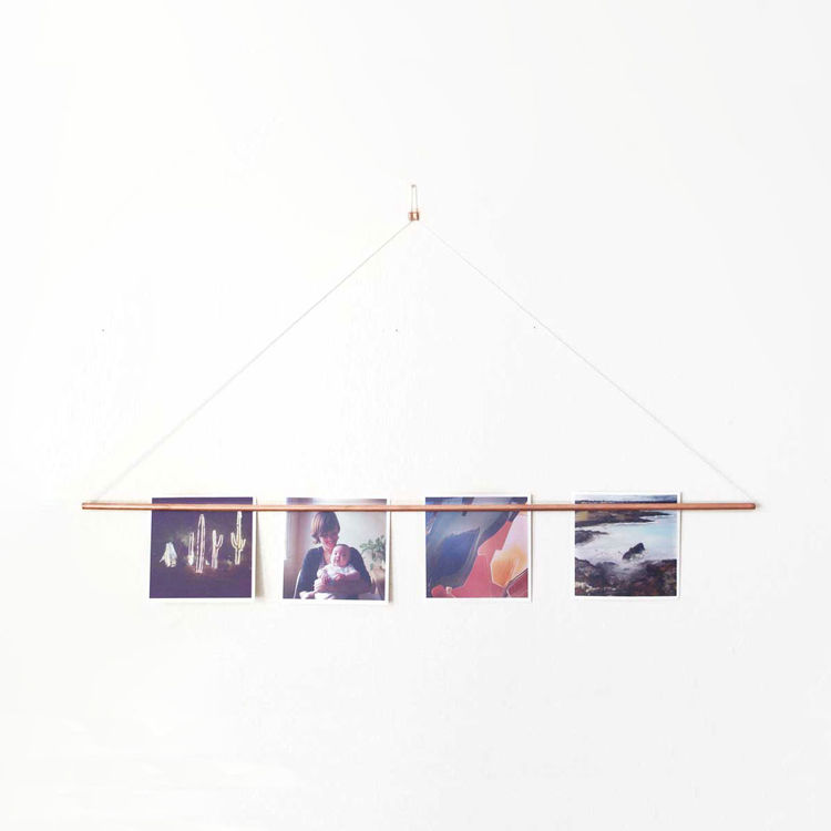 Copper photo hanging bar by Yield at Dwell on Design pop-up store at Dwell on Design Los Angeles.