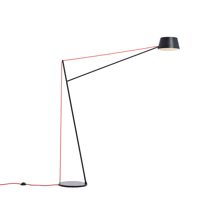 Modern cantilevered floor lamp with matte finish and contrast fabric cord