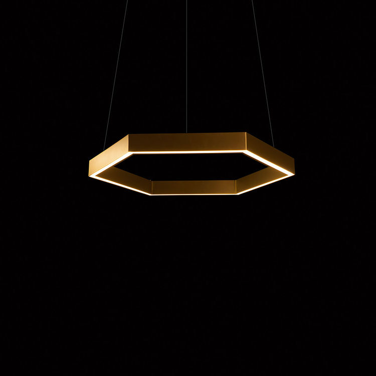 Brass hexagonal pendant light that provides shine to a dining room or living room space