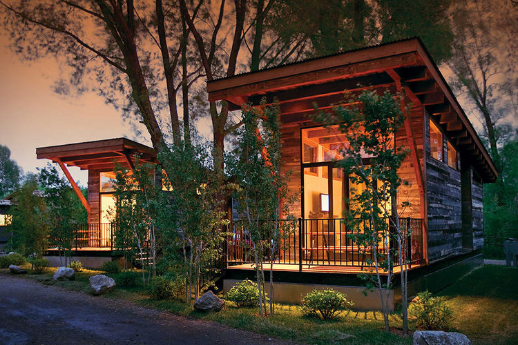 Modern prefab designed to resemble a log cabin
