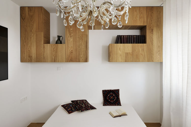 modern bedroom with built-in shelving