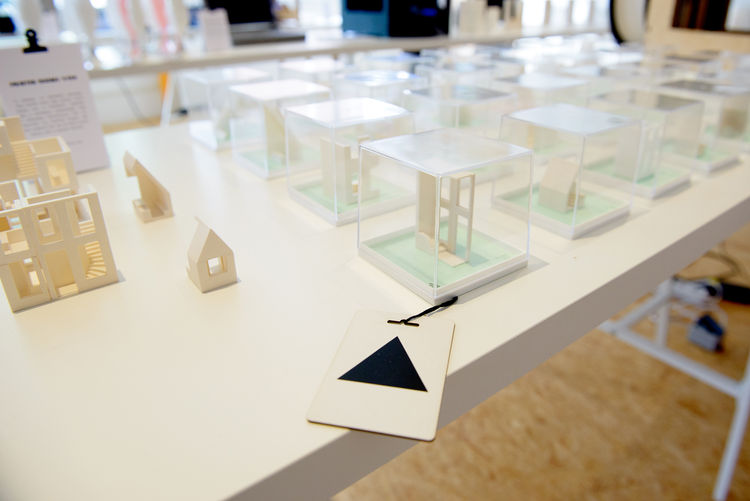 tiny models of 3-d printed house open to the public