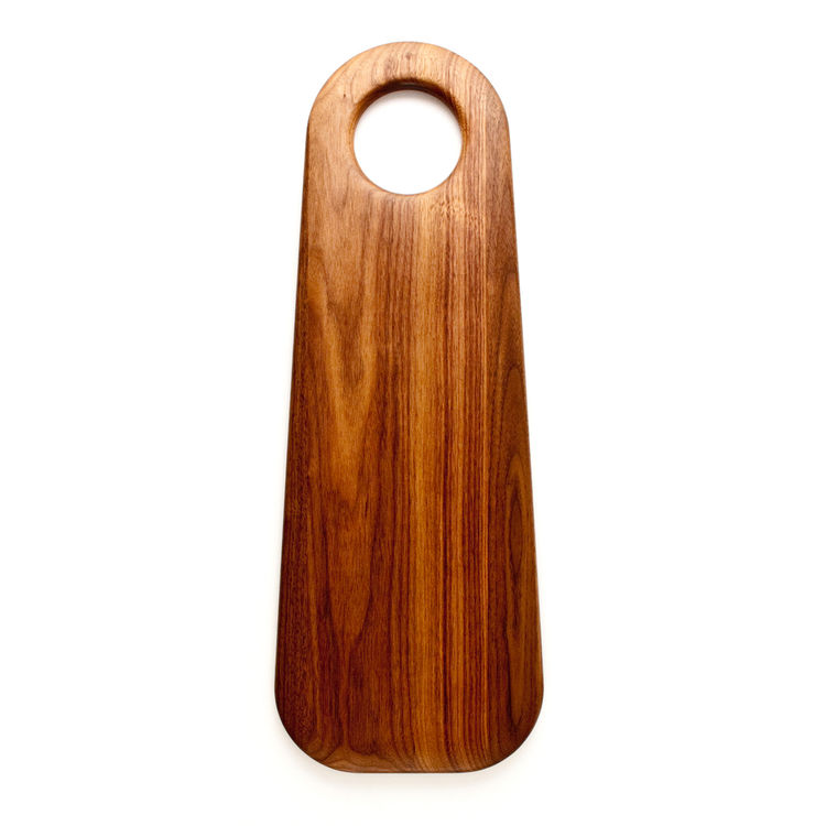 Elongated serving board made of walnut with convenient hanging hole