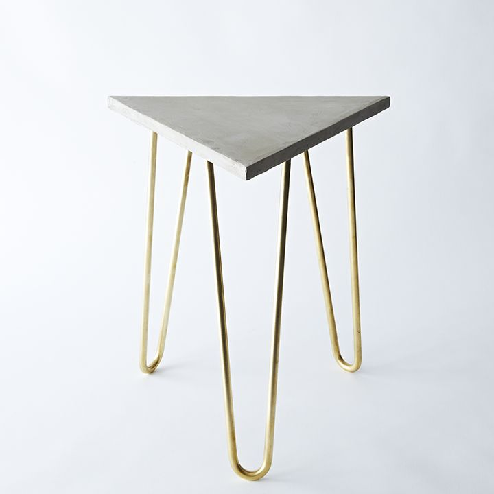 brass hairpin table with a concrete top