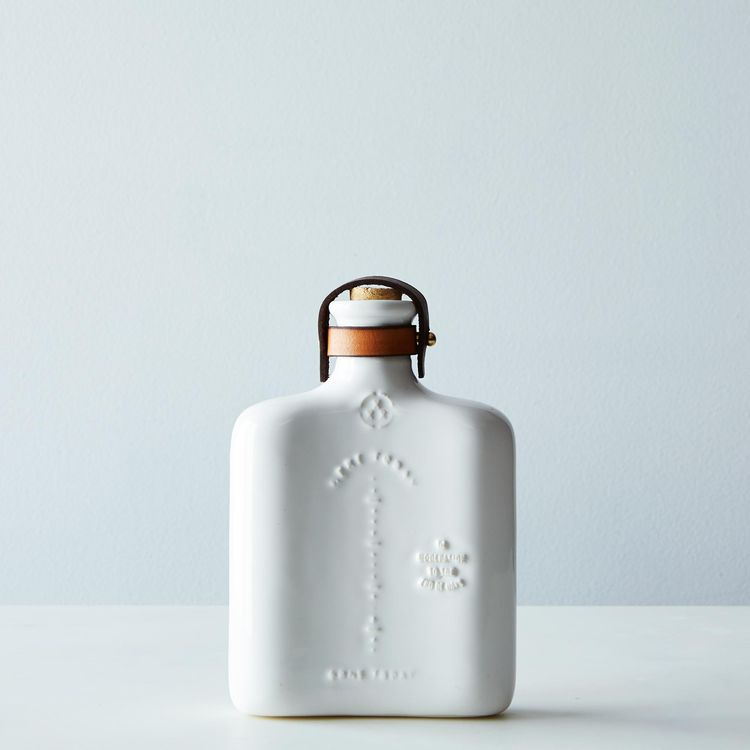 white ceramic flask
