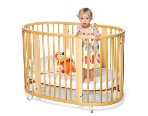 Modern wood crib with baby in it