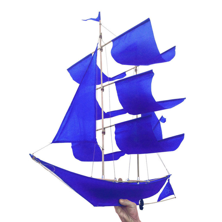 Ship-shaped kite in bold blue fabric