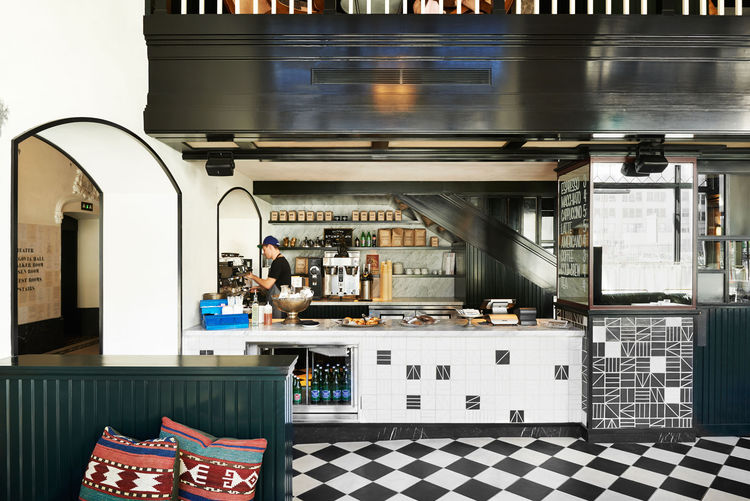 Modern coffee bar with black and white tile floor