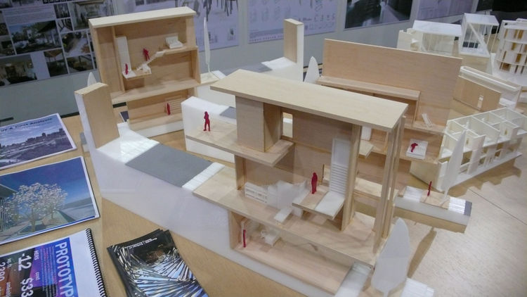 architectural models for zero-energy housing, featured on a tabletop