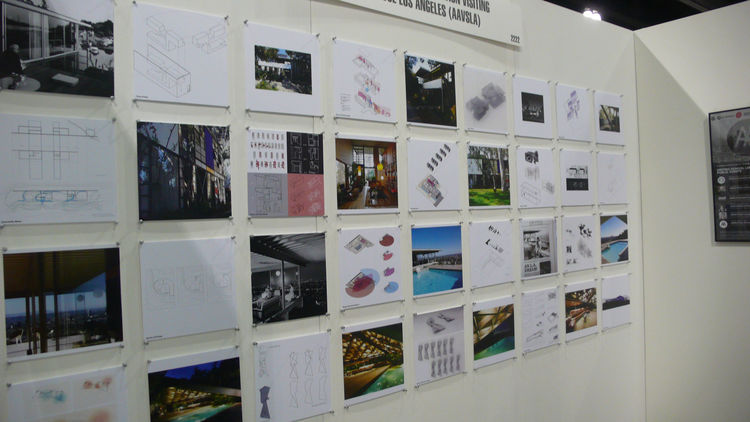 architectural drawings and photographs on a wall